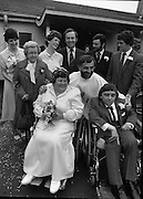 Historic Wedding Bells For Disabled Couple,  (N81)..1981..20.06.1981..06.20.1981..20th June 1981..Happy wedding bells chimed today for the first disabled couple in residential care to marry in the Republic of Ireland. The happy couple are Marie Skully and Pat Linehan and they were married in a special ceremony in The Cara Cheshire Home in the Phoenix Park. Both Marie and Pat are confined to wheelchairs because of their disabilities. After honeymoon, they will make their home in specially adapted quarters within the Cheshire residence...The New Mr and Mrs Linehan pose for wedding pictures outside the Cheshire home. They are accompanied by family and friends and by the Minister for Health, Dr Michael Woods TD..If you know the names of the priest and family members why not let us know and we will add them to the caption.