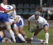 © Peter Spurrier / Intersport images.email images@intersport-images.com.21/6/03 Photo Peter Spurrier.Imber Court - Esher - Surrey.IRB U21 Rugby World Cup - Iffley Road - Oxford .Italy v Japan.Simone Picone (Capt. and scrum half) clears the ball from the base of the scrum