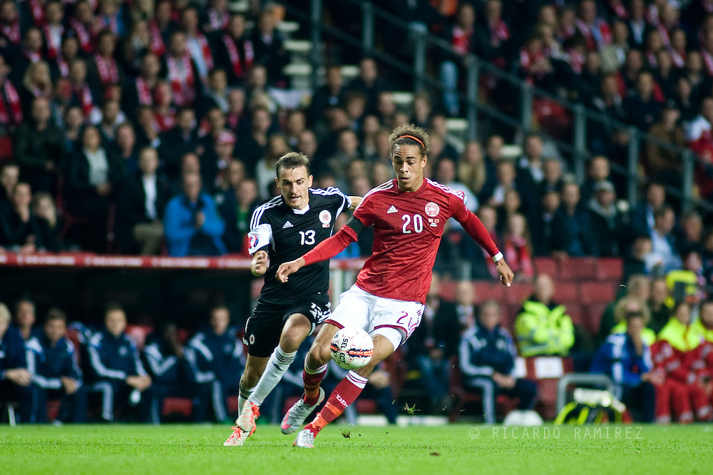04.09.2015. Copenhagen, Denmark. <br /> Yussuf Poulsen (R) of Denmark fights for the ball with Kukeli (L) of Albania during their UEFA European Champions qualifying round match at the Parken Stadium. <br /> Photo: © Ricardo Ramirez.