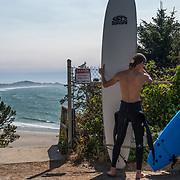 Surfers getting ready at Nye Beach. Newport, Oregon.