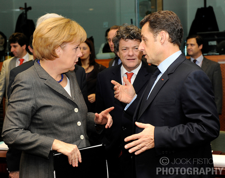 Angela Merkel, Germany's chancellor, left, speaks with Nicolas Sarkozy, France's president, during the second day of the European Summit, in Brussels, Belgium, Friday, Dec. 12, 2008. (Photo © Jock Fistick)