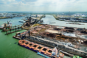 Nederland, Zuid-Holland, Rotterdam, 10-06-2015; Europoort, Ertsoverslagbedrijf Europoort C.V. (EECV) met bulk carriers voor de zeekade die worden gelost door grijperkranen. Dintelhavenhaven en Beneluxhaven.<br /> Europoort with bulk carriers at the terminals for dry bulk handling, ore and coal for German Steelmaking industry.<br /> <br /> luchtfoto (toeslag op standard tarieven);<br /> aerial photo (additional fee required);<br /> copyright foto/photo Siebe Swart