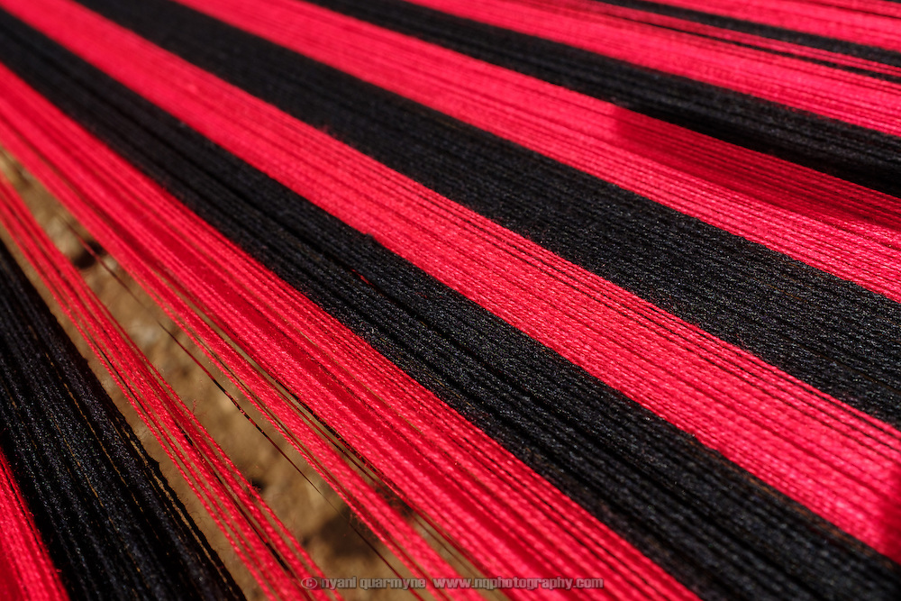 "Cloth being woven on a traditional loom in the village of Nanyaare in the Upper West region of Ghana. Pognaa Maabuora Sanduo I has facilitated the training of weavers in her community, as the sale of the cloth and clothes fashioned from it provides the women of her community with an income stream. A pognaa is responsible, in particular, for the wellbeing of women and children in her area of authority. While the title translates as ""woman chief"", in practice her authority is  subject to a male chief. The role of the pognamine (plural of pognaa) is being revived after having been suppressed during the colonial era, and they are increasingly seen as a force for development."