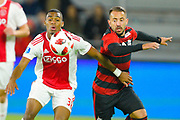 Ajax midefielder Ryan Gravenberch (38) and Flamengo forward Thiago Santos (40) go for a ball during a Florida Cup match at Orlando City Stadium on Jan. 10, 2019 in Orlando, Florida. <br /> Flamengo won in penalties 4-3.<br /> <br /> ©2019 Scott A. Miller