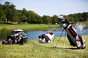 Players golf bags sit just off the 18th green during the 2012 Price Cutter Charity Championship at Highland Springs Country Club on August 10, 2012 in Springfield, Missouri. (David Welker/www.TurfImages.com).