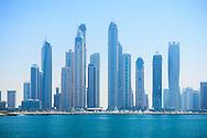 Dubai Marina skyline with high rise skyscraper apartment blocks.