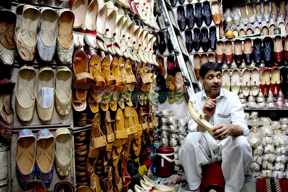 May 6, 2017 - Delhi, India - A Shopkeeper talks about the quality of the shoes to a customer in Old Delhi, on May 6, 2017. (Credit Image: © Nasir Kachroo/NurPhoto via ZUMA Press)