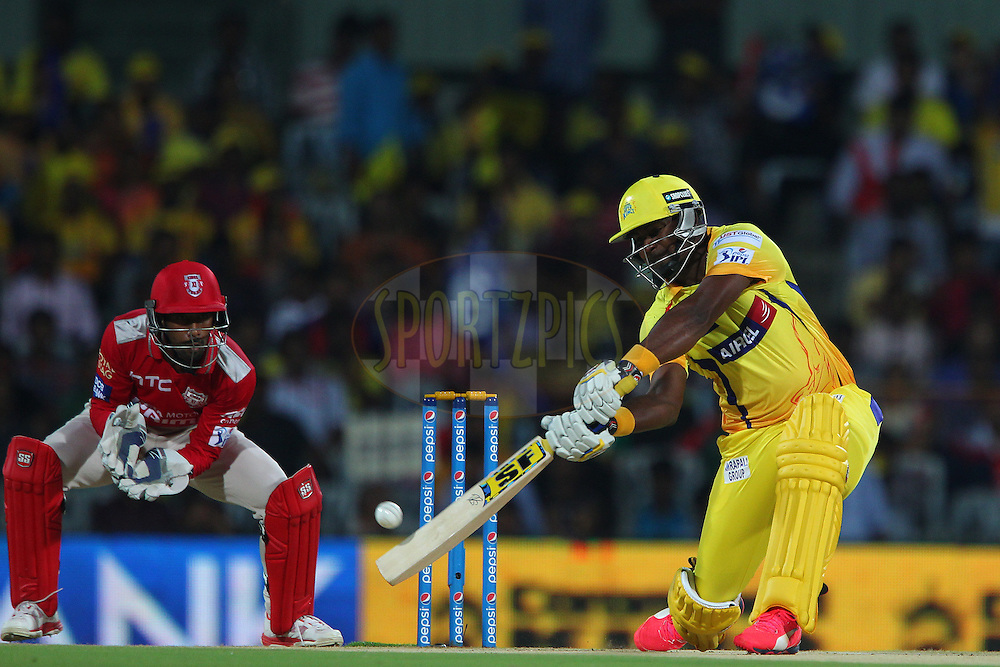 Dwayne Smith of the Chennai Superkings hits over the top for four from the first ball during match 24 of the Pepsi IPL 2015 (Indian Premier League) between The Chennai Superkings and The Kings XI Punjab held at the M. A. Chidambaram Stadium, Chennai Stadium in Chennai, India on the 25th April 2015.<br /> <br /> Photo by:  Ron Gaunt / SPORTZPICS / IPL
