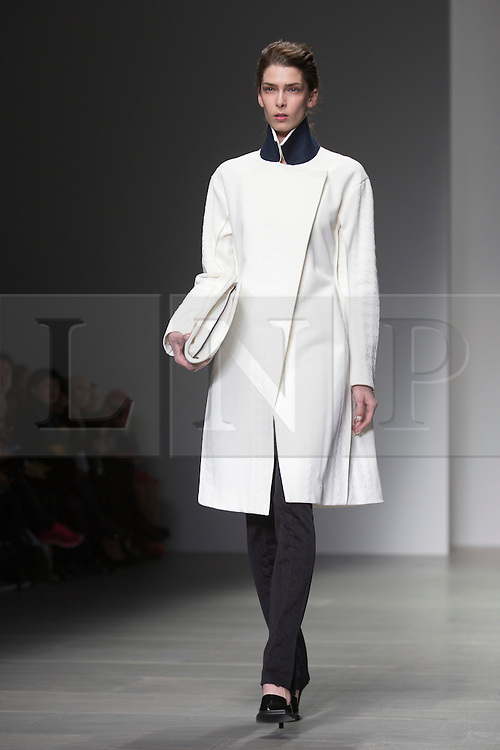© Licensed to London News Pictures. 14 February 2014, London, England, UK. London Fashion Week starts with the J JS Lee fashion show. A model walks the runway at the J JS Lee catwalk show during London Fashion Week AW14 at Somerset House. Photo credit: Bettina Strenske/LNP