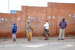 ALEXANDRA SOUTH AFRICA - APRIL 27: Residents in a queue during intensified testing and screening on Freedom Day, screening and testing includes people over over 60, flu-like symptoms, comorbid conditions, like diabetes, asthma, hypertencsion, HIV and tuberculosis on April 27, 2020 in Alexandra South Africa. Under pressure from a global pandemic. President Ramaphosa declared a 21 day national lockdown extended by another two weeks, mobilising goverment structures accross the nation to combat the rapidly spreading COVID-19 virus - the lockdown requires businesses to close and the public to stay at home during this period, unless part of approved essential services. (Photo by Dino Lloyd)
