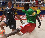Football-FIFA Beach Soccer World Cup 2006 - Group C-CAM_URU - Etienne Ngiladjoe-CAM- tries to overcome Diego,GK-URU. - Rio de Janeiro - Brazil 06/11/2006<br />Mandatory credit: FIFA/ Marco Antonio Rezende.