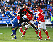 Simon Church (18) of Reading tries to backheel a cross into the net as Nathan Doyle (5) of Barnsley and Luke Steele (1) of Barnsley look on during the Npower Championship match between Reading and Barnsley on Saturday 25th September 2010 at the Madejski Stadium, Reading, UK. (Photo by Andrew Tobin/Focus Images)