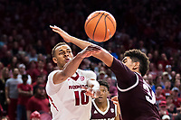FAYETTEVILLE, AR - FEBRUARY 17:  Daniel Gafford #10 of the Arkansas Razorbacks makes a pass while being defended by Tyler Davis #34 of the Texas A&M Aggies at Bud Walton Arena on February 17, 2018 in Fayetteville, Arkansas.  The Razorbacks defeated the Aggies 94-75.(Photo by Wesley Hitt/Getty Images) *** Local Caption *** Daniel Gafford; Tyler Davis
