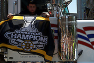 June 18, 2011, Boston, MA - A passenger in a truck holds up a chamionship banner. Photo by Lathan Goumas