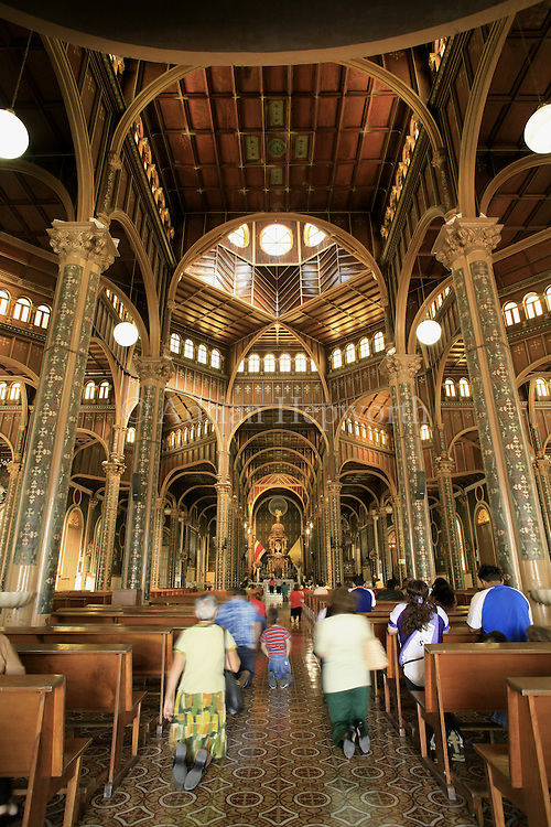 People entering La Basilica church on their knees, Cartago, Costa Rica.<br />