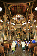 People entering La Basilica church on their knees, Cartago, Costa Rica.<br /> <br /> For pricing click on ADD TO CART (above). We accept payments via PayPal.