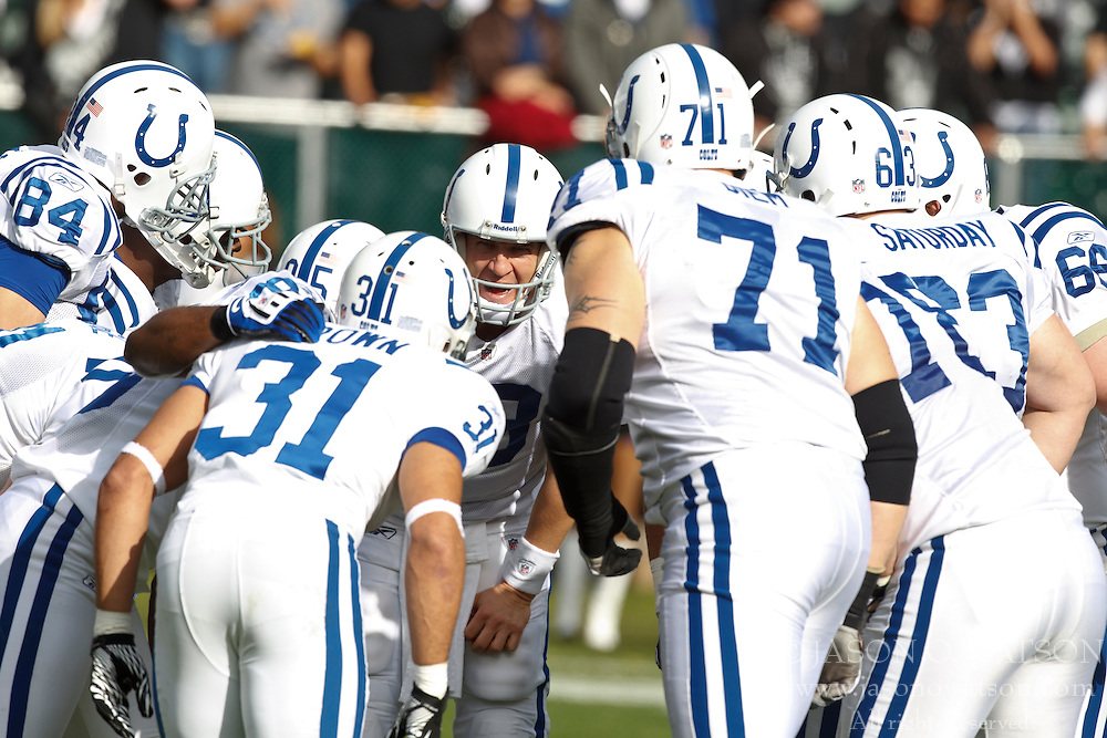 December 26, 2010; Oakland, CA, USA;  Indianapolis Colts quarterback Peyton Manning (center) calls a play in the huddle against the Oakland Raiders during the first quarter at Oakland-Alameda County Coliseum. Indianapolis defeated Oakland 31-26.