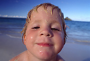 Boy on beach, Lanikai, Oahu, Hawaii<br />