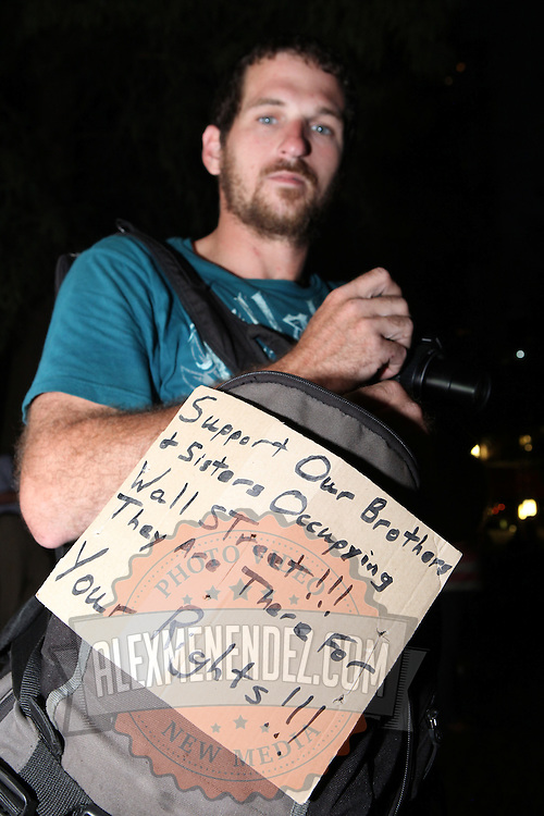 A supporter holds a sign during an Occupy Orlando public demonstration in support of Occupy Wall Street gatherings across the country, at the Orange County History Center on Wednesday, October 5, 2011 in Orlando, Florida. (AP Photo/Alex Menendez)