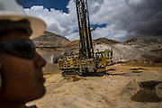 A supervisor looks on a drilling operation before a detonation during gold mining  in Yanacocha, Peru, Wednesday, October 21, 2015. (Hilaea Media/ Dado Galdieri)