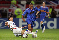 Photo: Paul Thomas.<br /> Lyon v Rangers. UEFA Champions League, Group E. 02/10/2007.<br /> <br /> Daniel Cousins (R) of Rangers is tackled by Kader Keita.