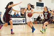 MMU's Perry Willett (5) drives to the hoop past North Country's Michaela Columbia (3) and Delaney Bryant (20) during the girls basketball game between the North Country Falcons and the Mount Mansfield Cougars at MMU high school on Monday night February 15, 2016 in Jericho. (BRIAN JENKINS/for the FREE PRESS)