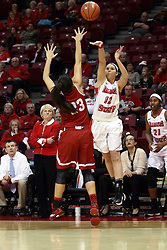 30 January 2015:  Lindsay Smith takes a last second three pointer which would tie the game over Leti Lerma, the ball misses the mark during an NCAA women's basketball game between the Bradley Braves and the Illinois Sate Redbirds at Redbird Arena in Normal IL