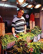 Vegetable salesman in Chinatown neighborhood of New York City.