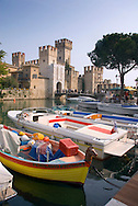 Sirmione, Lago di Garda, Italy, May 2009. Fishing boats and tour boats. The Medieval castle of Sirmione. Sirmione is a popular and pretty historical town perched on a headland and surrounded by the waters of Lake Garda. The northern part of the lake area is loved by sportive people, while the south is known for its relxed atmosphere. Photo by Frits Meyst/Adventure4ever.com
