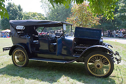 7 August 2010: 1917 Chandler Model 17 7 passenger.  Built by Chandler Automobile Company in Cleveland Ohio. New cost was $1395 and the wire wheels were a $500 option.  Comparable the Model T Ford cost $395.  This is the only complete and running Chandler know to exist and is owned by Brady and Emily Mann of Roanoake, Illinois. Antique Car show, David Davis Mansion, Bloomington Illinois