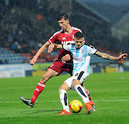 Jamie Paterson of Huddersfield Town is taqcklede by Daniel Ayala of Middlesbrough during the Sky Bet Championship match at the John Smiths Stadium, Huddersfield<br /> Picture by Graham Crowther/Focus Images Ltd +44 7763 140036<br /> 28/11/2015