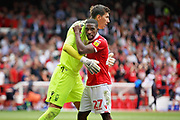 Nottingham Forest defender Tendayi Darikwa (27)  and Nottingham Forest goalkeeper Costel Pantilimon (1) celebrate after the EFL Sky Bet Championship match between Nottingham Forest and Reading at the City Ground, Nottingham, England on 11 August 2018.