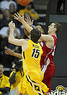 January 19 2013: Wisconsin Badgers forward Ryan Evans (5), Wisconsin Badgers forward Zach Bohannon (34), and Iowa Hawkeyes forward Zach McCabe (15) battle for a rebound during the second half of the NCAA basketball game between the Wisconsin Badgers and the Iowa Hawkeyes at Carver-Hawkeye Arena in Iowa City, Iowa on Sautrday January 19 2013. Iowa defeated Wisconsin 70-66.