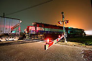 It's 3am in the small prairie town of Gilman, IL, and all is quiet save for the sounds of the crossing gate bell and idling diesel locomotives.