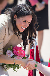 PICTURE RE-TRANSMITTED WITH CORRECT CAPTION INFORMATION The Duchess of Sussex meets members of the public during a walkabout outside the Sydney Opera House, in Sydney on the first day of the Royal couple's visit to Australia.