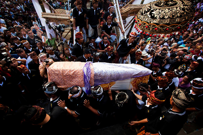 the coffin of Anak Agung Niang Rai march around the cremation point in Pelebon ceremony of Anak Agung Niang Rai of Puri Agung Ubud, The wife of King Of Ubud. Pelebon Ceremony or  Ngaben ceremony is a ceremony to purify and return the  five element of the universe that form the life itself in human body to the universe