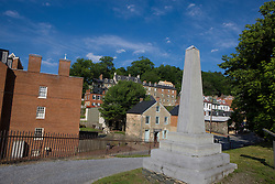 Obelisk monument designating the original site of John Brown's Fort, Harpers Ferry National Historical Park, Harpers Ferry, West Virginia..Harpers Ferry National Historical Park is located at the confluence of the Potomac and Shenandoah rivers in and around Harpers Ferry, West Virginia. The park includes land in the adjacent states of Maryland and Virginia. The park is managed by the National Park Service, an agency of the U.S. Department of the Interior. Originally designated a National Monument in 1944, the park was declared a National Historical Park by the U.S. Congress in 1963. The park includes the historic town of Harpers Ferry, notable as a center of 19th century industry and as the scene of John Brown's abolitionist uprising. The park was listed on the National Register of Historic Places on October 15, 1966.