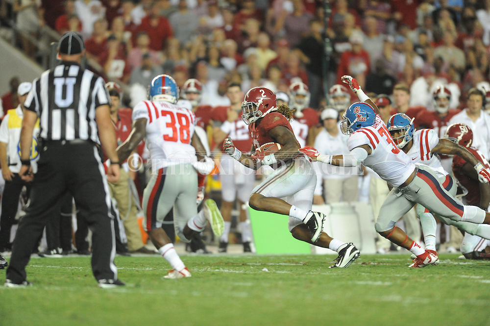 Ole Miss Rebels linebacker DeMarquis Gates (31) vs. Alabama Crimson Tide running back Derrick Henry (2) at Bryant-Denny Stadium in Tuscaloosa, Ala. on Saturday, September 19, 2015. Ole Miss won 43-37.