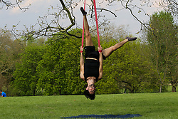© Licensed to London News Pictures. 12/04/2020. London, UK. A man exercising using the aerial suspension in Finsbury Park, north London during coronavirus lockdown. Over 10,000 people in the UK have died in hospitals due to COVID-19. Photo credit: Dinendra Haria/LNP