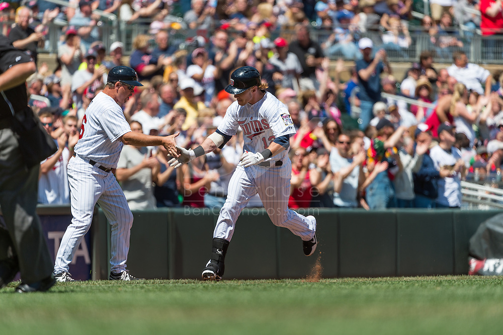 Chris Herrmann #12 of the Minnesota Twins is congratulated by 3rd base coach Joe Vavra #46 after hitting his first career home run against the Seattle Mariners on June 2, 2013 at Target Field in Minneapolis, Minnesota.  The Twins defeated the Mariners 10 to 0.  Photo: Ben Krause