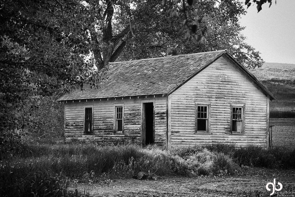 "I saw this cottage from the road between Fromberg and Joliet, Montana.  There was a ""No Trespassing"" sign posted just past the house.  I threw on a long lens and took three frames."