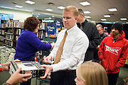 "09 DECEMBER 2010 - PHOENIX, AZ: People pick up autographed copies of George W. Bush's book, ""Decision Points"" at the Barnes & Noble Bookstore in Phoenix, AZ, Thursday, Dec. 9. More than 2,000 people lined up starting at 5AM to get copies of the former President's book, ""Decision Points."" A handful of protesters demonstrated against President Bush near the bookstore, calling him a ""war criminal.""   PHOTO BY JACK KURTZ"