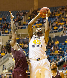 Dec 13, 2015; Morgantown, WV, USA; West Virginia Mountaineers forward Elijah Macon (45) shoots in the lane during the first half against the Louisiana Monroe Warhawks at WVU Coliseum. Mandatory Credit: Ben Queen-USA TODAY Sports