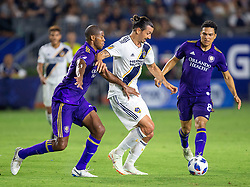 July 29, 2018 - Carson, California, U.S - Zlatan Ibrahimovic #9 of the LA Galaxy dribbles in between defenders during their game with the Orlando City on Sunday July 29, 2018 at StubHub Center in Carson, California. LA Galaxy defeats Orlando City, 4-3. (Credit Image: © Prensa Internacional via ZUMA Wire)