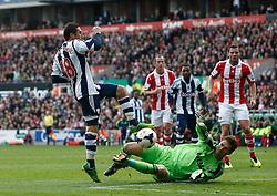 Stoke City's Asmir Begovic denies West Bromwich Albion's Morgan Amalfitano - Photo mandatory by-line: Matt Bunn/JMP - Tel: Mobile: 07966 386802 19/10/2013 - SPORT - FOOTBALL - Britannia Stadium - Stoke-On-Trent - Stoke City V West Brom - Barclays Premier League
