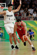14th April 2018, Gold Coast Convention and Exhibition Centre, Gold Coast, Australia; Commonwealth Games day 10, Basketball, Mens semi final, New Zealand versus Canada; Ammanuel Diressa of Canada dribbles the ball around Reuben Te Rangi of New Zealand