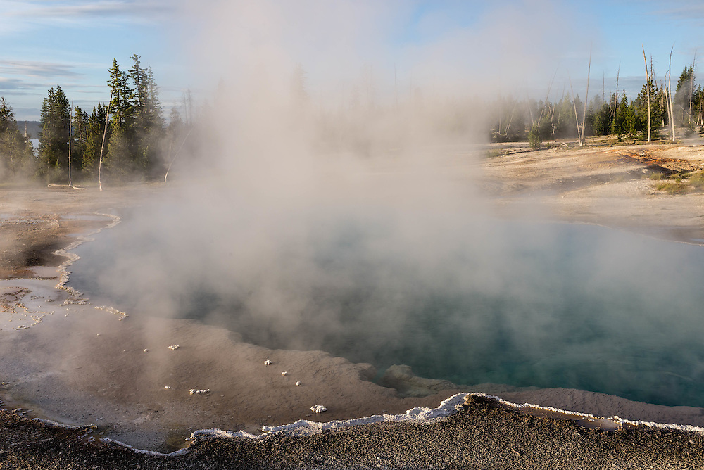Morning Light strikes Black Pool in the West Thumb Geyser Basin