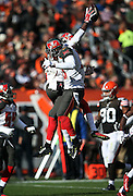 Tampa Bay Buccaneers cornerback Johnthan Banks (27) leaps in the air and celebrates after intercepting a second quarter pass during the NFL week 9 regular season football game against the Cleveland Browns on Sunday, Nov. 2, 2014 in Cleveland. The Browns won the game 22-17. ©Paul Anthony Spinelli