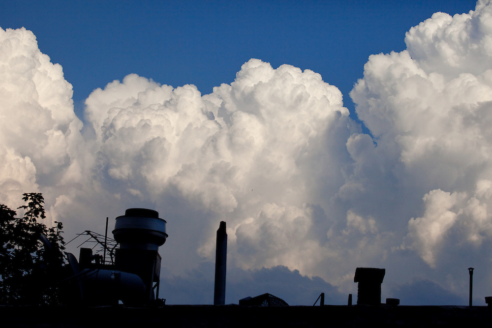 Cumulonimbus clouds on a warm clear late July afternoon. These clouds may have eventually turned into rain clouds.