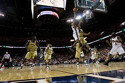 Virginia Cavaliers point guard Sean Singletary (44) shoots over Georgia Tech Yellow Jackets Forward Jeremis Smith (32).  The Virginia Cavaliers Men's Basketball Team defeated the Georgia Tech Yellow Jackets 75-69 at the John Paul Jones Arena in Charlottesville, VA on February 24, 2007.